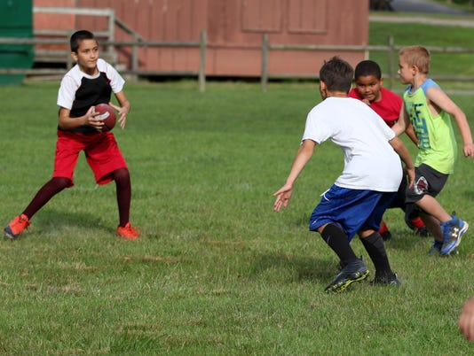 BMN 072717 B4 Football camp