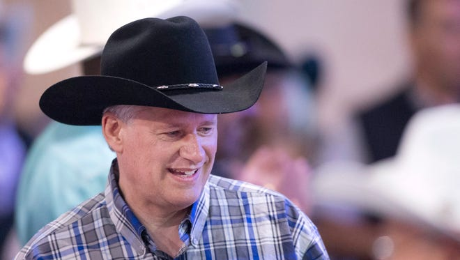 Canadian Prime Minister Stephen Harper mingling at the annual South West Stampede BBQ in Calgary, Alberta, on July 4 , 2015.
