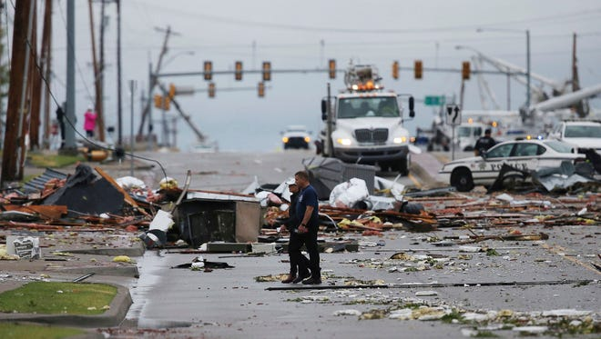 Debris from a storm covers a street in Tulsa, Okla., Sunday, Aug. 6, 2017.