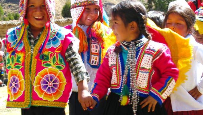 Q'ero children dance outside.