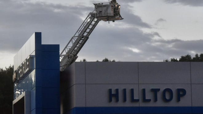 Firefighters battle a blaze at Hilltop Chevrolet in Somersworth Friday night.