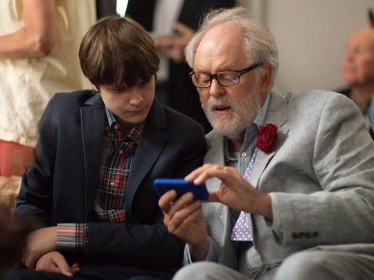 """This image released by Sony Pictures Classics shows Charlie Tahan , left, and John Lithgow in a scene from """"Love Is Strange."""" (AP Photo/Sony Pictures Classics, Jeong Park)"""