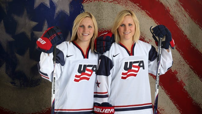 Monique Lamoureux (right) poses with her sister Jocelyne Lamoureux (left) during a portrait session at the Team USA Media Summit at Canyons Grand Summit Hotel in Park City, Utah, on Oct. 2.