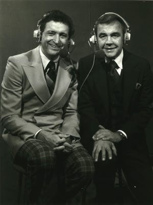 """Former Marquette University basketball coach Al McGuire (left) and Dick Enberg made a memorable broadcasting team. Enberg paid tribute to his former TV partner by writing a one-man play, """"McGuire."""""""