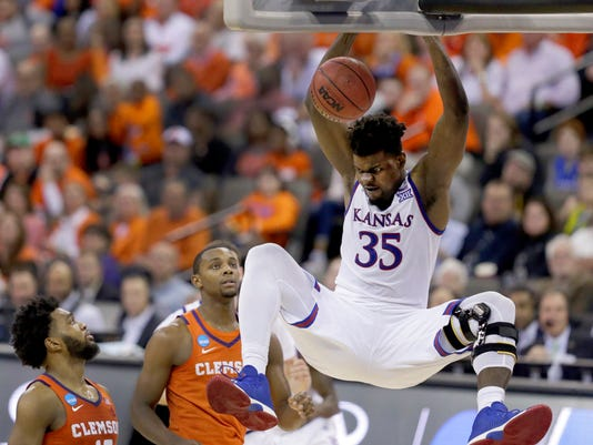 Kansas' Udoka Azubuike (35) dunks as Clemson's Gabe DeVoe, left, and Aamir Simms watch during the second half of a regional semifinal game in the NCAA men's college basketball tournament Friday, March 23, 2018, in Omaha, Neb. Kansas won 80-76. (AP Photo/Charlie Neibergall)
