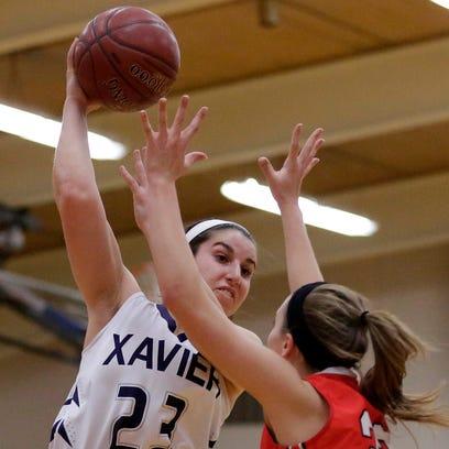 Rachel Siciliano of Xavier jumps to pass over Kali