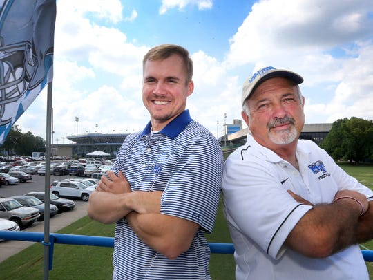 Will Daniel and Danny Farrer, the owner of the Hillbilly Hilton on top of the bus on Thursday, Sept. 1, 2016., as they prepares for tailgating before the MTSU vs. Alabama A&M game Saturday.