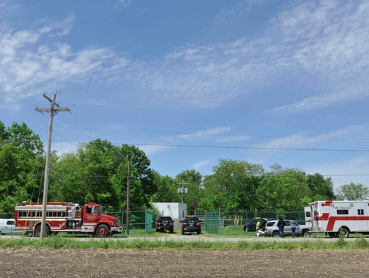 Emergency responders gather near the scene of a drowning