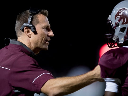 Alabama Christian coach Nate Sanford coaches against