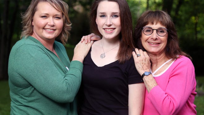 Brittan Gilmore, center, who was conceived with an egg donor, is photographed with egg donor JoLana Talbot, left, and mother Janet Schreibman, right, at her home in Brentwood Tuesday, May 10, 2016.