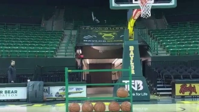 Baylor basketball managers posted a unique trick shot video.