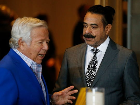 Jacksonville Jaguars owner Shahid Khan, right, talks with New England Patriots owner Robert Kraft at the NFL meetings Monday, March 27, 2017, in Phoenix.