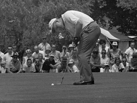 FILE--Jack Nicklaus putts on the first green at the U.S. Open championship in Oakmont, Pa., June 17 1962. Nicklaus won his first major championship at the U.S. Open in 1962 defeatinng Arnold Palmer by three strokes in a playoff to win the U.S. Open.