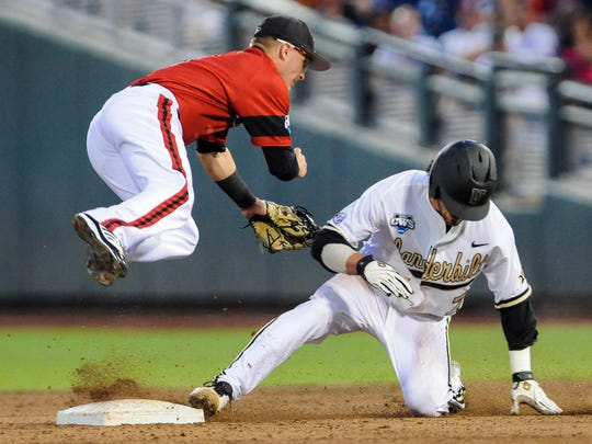 Vanderbilt's Dansby Swanson, right, steals second base in the fourth inning of Saturday's game.