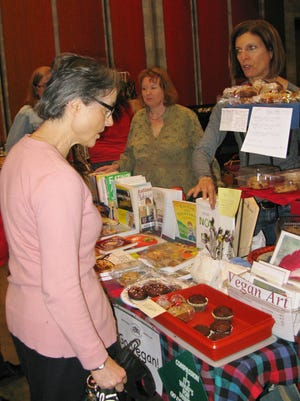 One visitor is attracted to a display of children's books.
