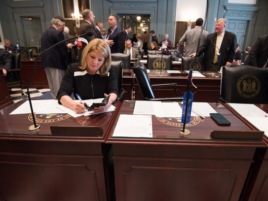 House Majority Leader Rep. Valerie Longhurst, D-Bear, works at her desk before the start of the second half of the 149th legislative session in Dover.