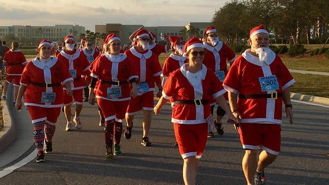 Santas approach the Run Run Santa finish line