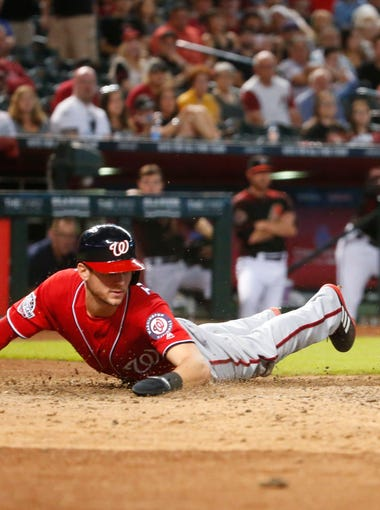 Arizona Diamondbacks catcher John Ryan Murphy (36) outs Washington Nationals shortstop Trea Turner (7) at home during a MLB game at Chase Field in Phoenix, Az., on May 12, 2018.