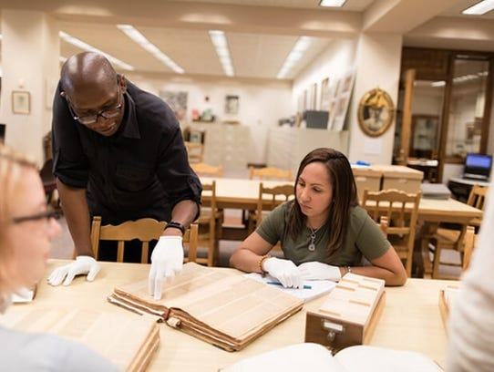 History professor Julian Chambliss works with students