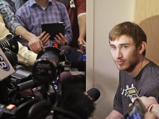 FILE - In this April 17, 2014 file photo, Utah Jazz's Gordon Hayward speaks to the media in Salt Lake City. A person close to the situation says restricted free agent Hayward has agreed to a maximum offer sheet with the Charlotte Hornets that would pay the small forward $63 million over the next four years. The Jazz would have three days to match the deal once Hayward officially signs the offer sheet. The person commented to The Associated Press on condition of anonymity Wednesday, July 9, 2014, because Hayward can't officially sign the offer sheet until Thursday. (AP Photo/Rick Bowmer, File)