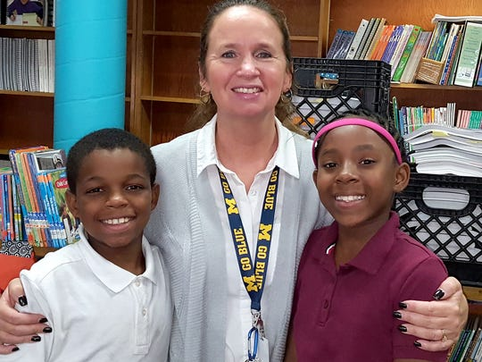 Xavier Purches, left, and  A'Layia Samon Howard, right, with Kathy Savoie, their chaperone to Washington, D.C. Savoie is a 5th-grade teacher at Freeman Elementary School in Flint.