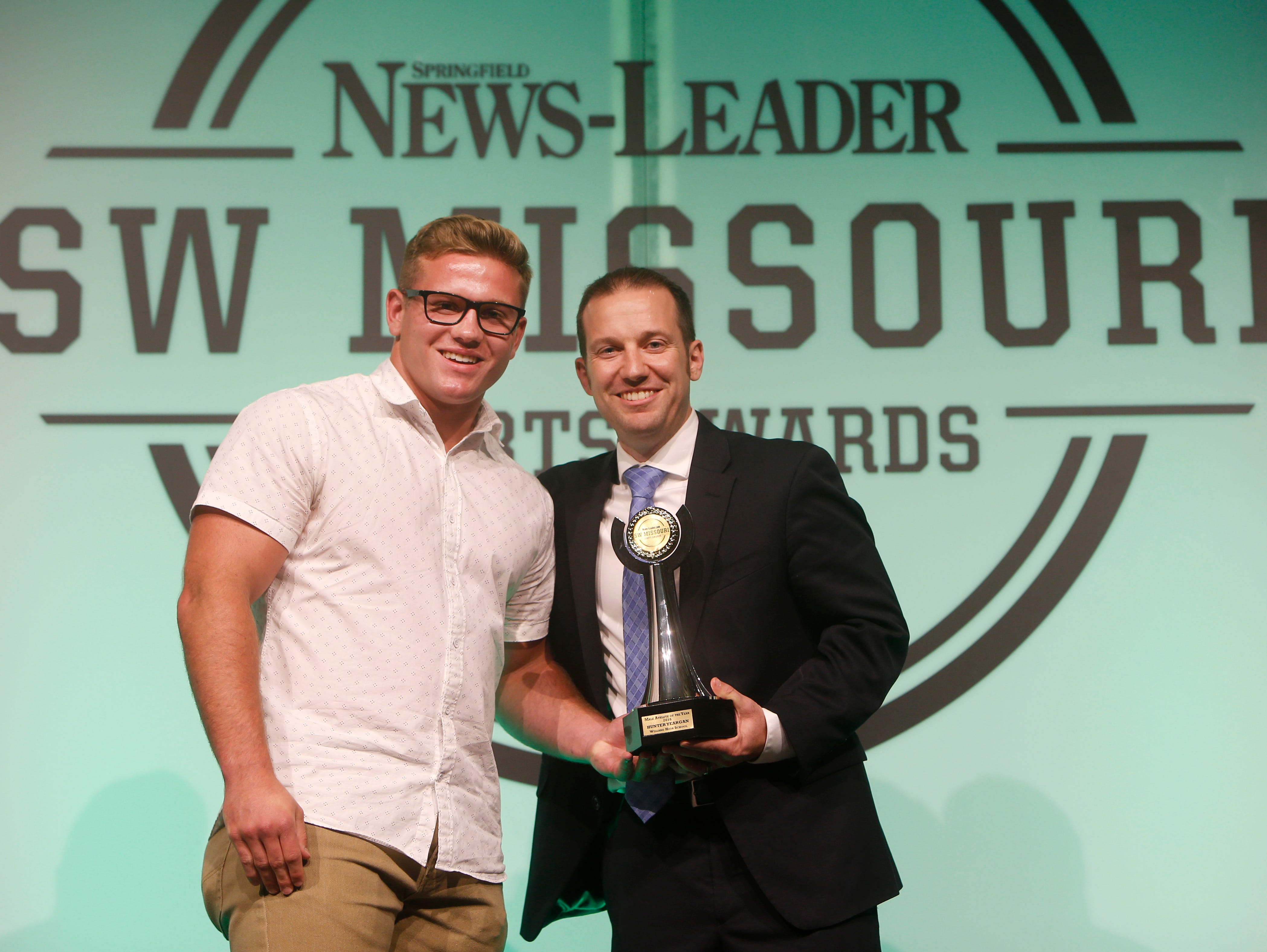 Willard wrestler Hunter Yeargan was named the male athlete of the year during the 2016 Southwest Missouri Sports Awards at the Springfield Expo Center on Thursday, June 9, 2016. Presenting him with the award is News-Leader President Allen Jones.