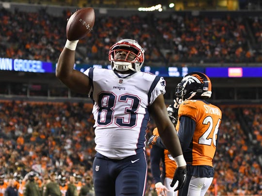New England Patriots tight end Dwayne Allen (83) celebrates his touchdown reception in the second quarter against the Denver Broncos at Sports Authority Field.