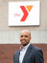 YMCA CEO Derrick Stewart stands outside of the Downtown YMCA in Evansville, Ind., Thursday, March 1, 2018.
