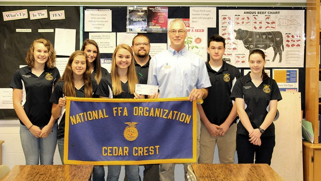 Zoetis, a global animal health company, and area veterinarians continue to support Cedar Crest FFA through donations that provide assistance to the students for participation in leadership conferences and other opportunities. This year, both Agricultural Vet Associates (Dr. Peter Harris) and 5th Avenue Animal Hospital (Dr. Gary Brummel) have provided donations to Cedar Crest FFA totaling almost $900. Here, Harris presents the check from Zoetis to the officers, from left, Hannah Woelfling; Brooke Heagy; Coral Hetrick; Mackenzie Peiffer; Phil Haussener; FFA Adviser;  Andrew Krall; and Kezia Burkholder.
