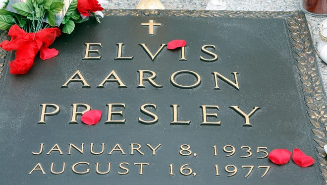 The grave of Elvis Presley at Graceland, Presley's home in Memphis, is seen Jan. 8, 2010, Presley's 75th birthday. This year marks the 40th anniversary of his death.
