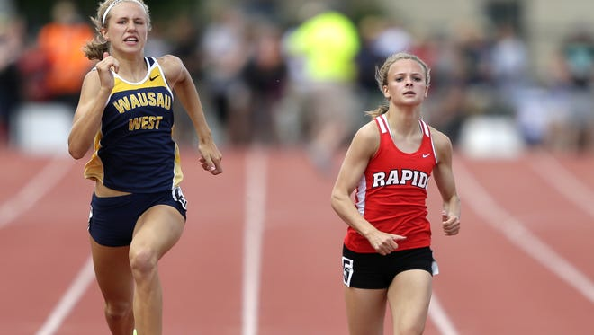 Grace Hartman, right, broke a 30 year old facility record in the 200 meter Friday at the Panther Girls Invite