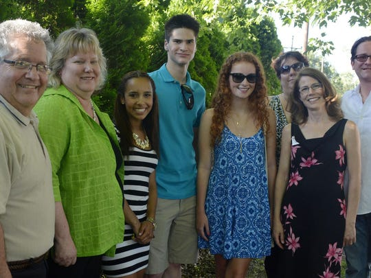 Scholarship winners from Fanwood and Scotch Plains were honored recently at a cookout at LaGrande Park by the Fanwood Business and Professional Association (FBPA) and its counterpart in Scotch Plains. Scholarship winners Arianna Correa, third from left, Steven Davies and Rachel Lavelle pose with Steve Goldberg of the SPBPA, Mindy Scarlett of the FBPA, Lisa Mohn of the SPBPA (rear) and Jeni DiVirgilio and Brian Walter of the FBPA.