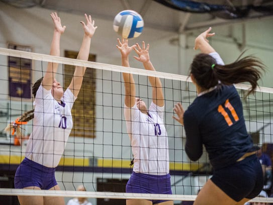 Bronson's Kiana Mayer (10) and Jill Pyles (13) block