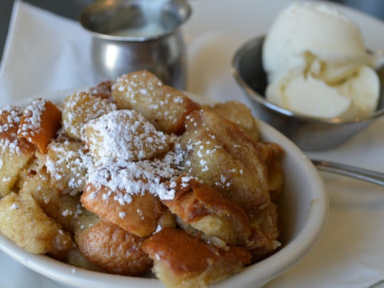 Bourbon bread pudding is made with french bread and golden California raisins andtopped with a scoop of Oscar's vanilla frozen custard and bourbon vanilla butter cream sauce for $7.95.