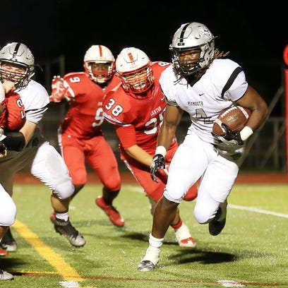 Plymouth running back Darius Timmons (No. 4) tries