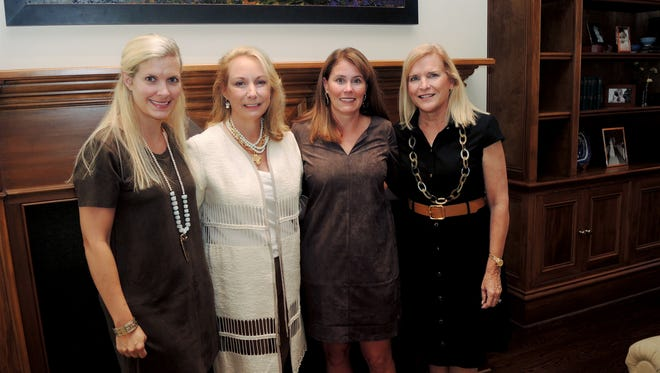 Meg White, left, Robin Puryear, Whitney Musser and Julie Walker at the Swan Ball 2017 Committee Kickoff held at the home of Jamee Thompson.