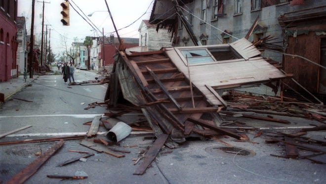 Parts of buildings clutter the streets of Charleston after Hurricane Hugo in September 1989 file photo.