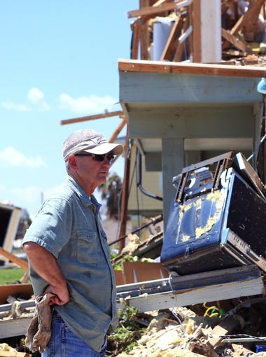 Kim Weatherford surveys the damage at his vacation home in Copano Cove in Rockport, TX on August 30, 2017. The home sustained major damage from Hurricane Harvey.