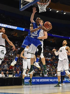 Middle Tennessee Blue Raiders guard Jaqawn Raymond (10) goes up for a shot during the second half of the first round against the Michigan State Spartans in the 2016 NCAA Tournament at Scottrade Center.