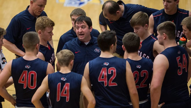 Heritage Hills' head coach Nate Hawkins talks with his team during a timeout during the Class 3A Boonville Sectional at Boonville High School on Tuesday, Feb. 27, 2018. Memorial defeated Heritage Hills 66-57.