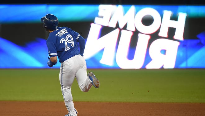 Devon Travis rounds the bases after hitting a two run home run in the seventh inning.
