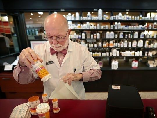 Pharmacist Rick Talley fills prescriptions at the Good