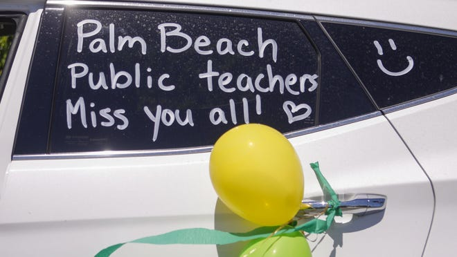 Palm Beach Public School teachers parade on March 30 through the school's neighborhood in an effort to reconnect with students and families they haven't seen since the community began social distancing to guard against the coronavirus.