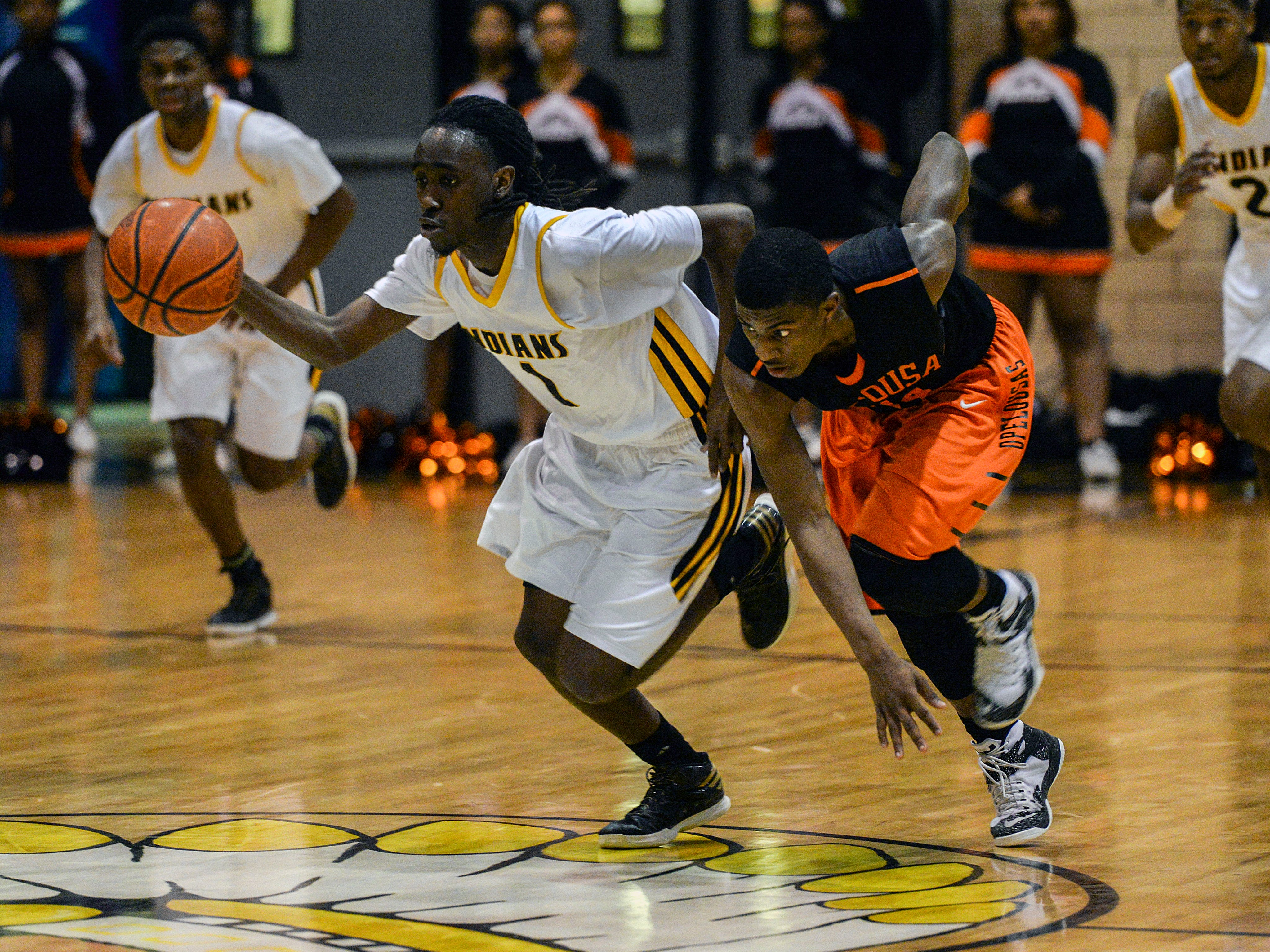Donnie Perkins of Fair Park makes the fast break with Kaylan Coleman of Opelousas on his heels during their first round playoff game Friday night. Fair Park won 66-53.