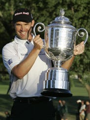 Padraig Harrington, of Ireland, holds up the Wanamaker