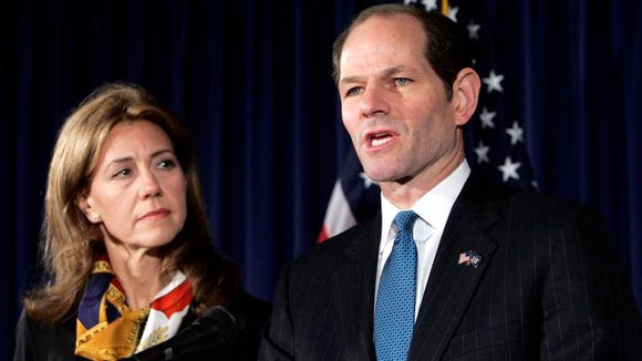 Amid a prostitution scandal, New York Gov. Eliot Spitzer resigned in March 2008. His wife, Silda Wall Spitzer, stood at his side.
