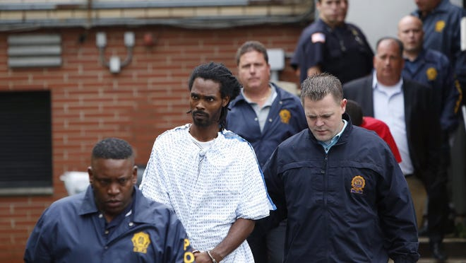 Taqiy A. Walton, one of the two men facing attempted murder charges in the shooting of a retired police officer enters the Greenburgh courthouse Tuesday.