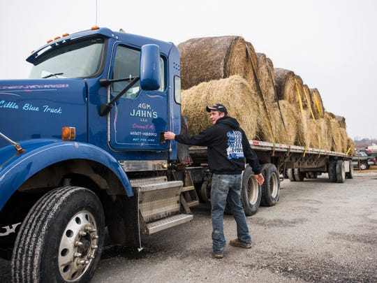 Kyle Reid of Deckerville gets in a truck Sunday, Mar. 26, as he departs for Kansas from Croswell for a farmer relief effort.