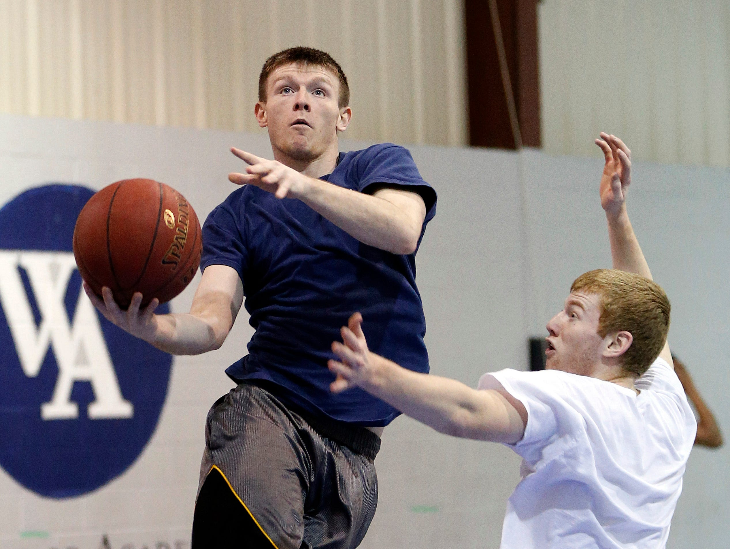 Woodward Academy senior guard Preston Brittain puts up a shot during basketball practice last week. The Knights have qualified for the Class 2-A state boys' basketball tournament, and they'll play top-seeded Aplington-Parkersburg in a quarterfinal game at 8:15 p.m. Monday at Wells Fargo Arena.