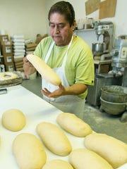 Lujan Bakery co-owner Enrique Sanchez makes fresh Rosca